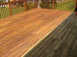 Comparison of pressure washed wooden deck versus unwashed deck.